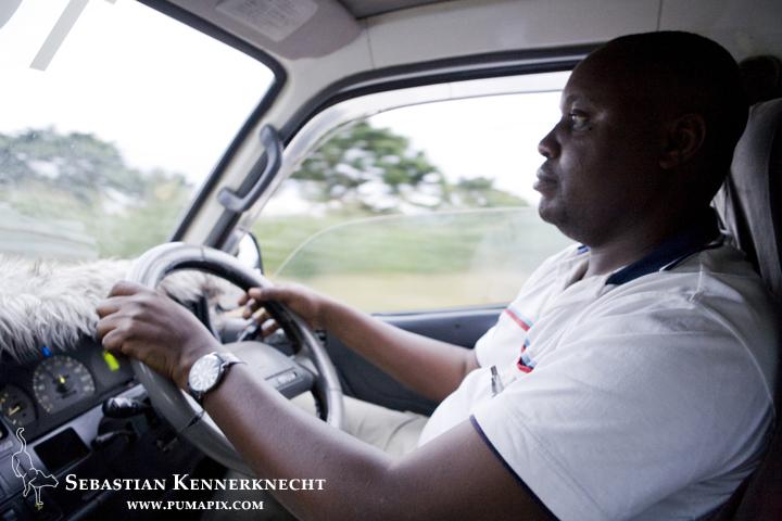 Francis driving, Uganda